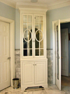 Specialty fretwork door cabinet built by Tom Scott